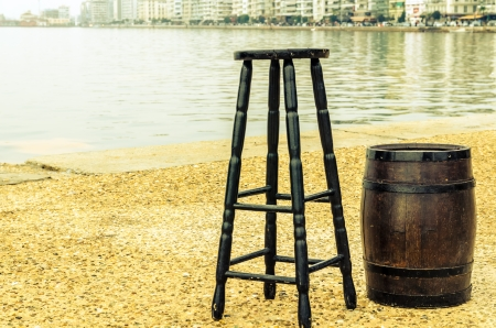Chair and barrel by the sea  Stock Photo