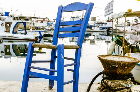 blue chair on the harbot in Thessaloniki  Stock Photo