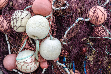 Fishing net with red and white balls  Stock Photo