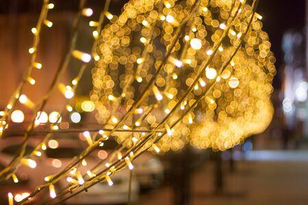 Night city street with vivid illumination Фото со стока