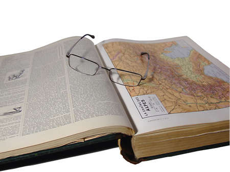 censor: glasses and open atlas (path included) Stock Photo