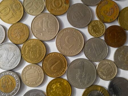 Different country coins on white background. Currencies of various countries of the world. Use of copper and nickel.