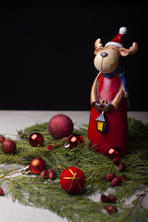 New Year's toy irvas photographed on a black background decorated with New Year gifts Stock Photo