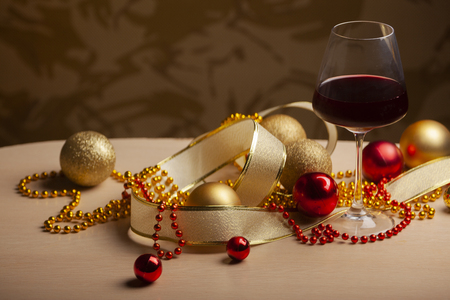 New Years and Christmas arrangement with decorations and glasses of wine