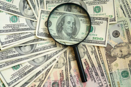 photography of the dollars with magnifying glass                                photo