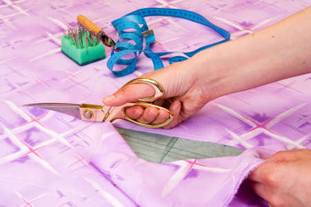 dressmaker cuts scissors fabrics photo