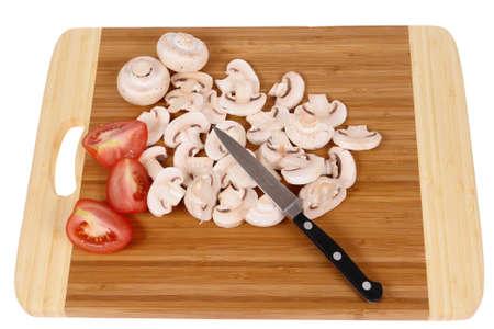 まな板: mushrooms to cut on brown chopping board                                  写真素材