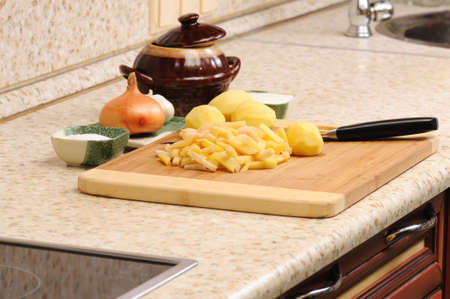 meal preparation: Meal preparation on kitchen from a potato