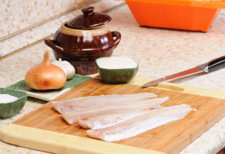 meal preparation: Meal preparation on kitchen from a fish Stock Photo