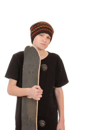 The teenager with a skateboard and in a hat isolated on white background photo