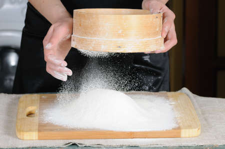 sift: Flour sifting through a sieve for a baking