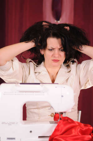 threading hair: The woman was upset because at it the dress has not turned out Stock Photo
