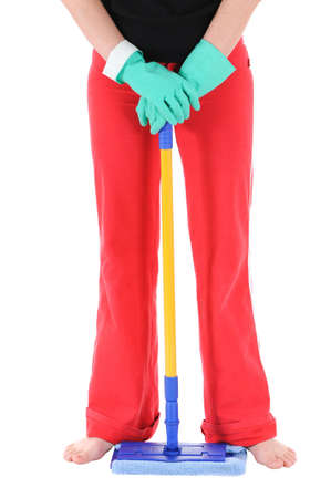 The woman in green gloves holds a mop photo