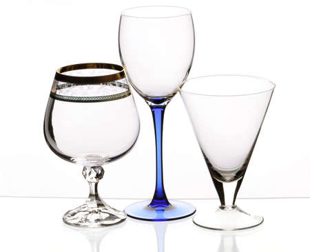 Three transparent empty glasses stand on a table photo