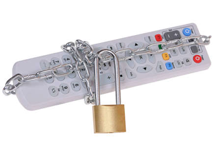 The television remote control is closed by the padlock with a chain isolated on white background photo