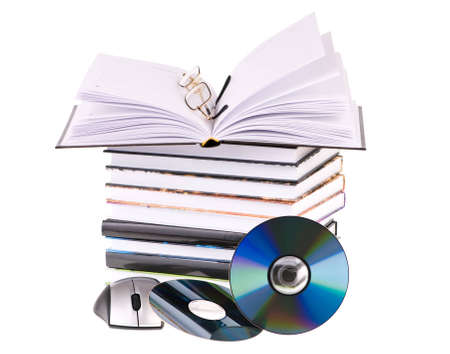 stack of books with pen glasses and a computer mouse photo