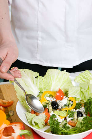 Preparation of salad from cheese and fresh vegetables photo
