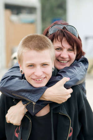 teenage love: The happy mother and a son hugging and laughing Stock Photo