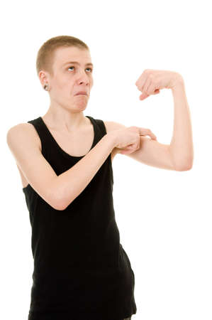 тощий: смешно тощий подросток показывает бицепсы на белом фоне Фото со стока