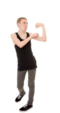 funny skinny teen shows biceps isolated on white background photo