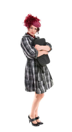 The woman with a bag in a ladies hat isolated on white background photo