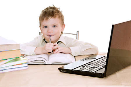 boy pupil thinks for in time  homework Stock Photo - 12353333