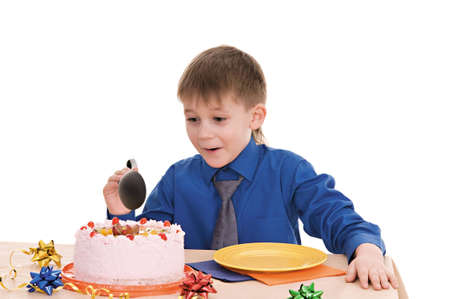 child with a large spoon is going to eat cake isolated on white background photo