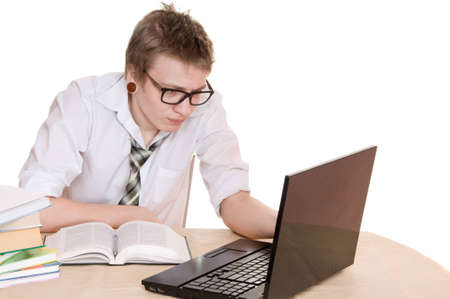 male student works on the laptop isolated on white background photo