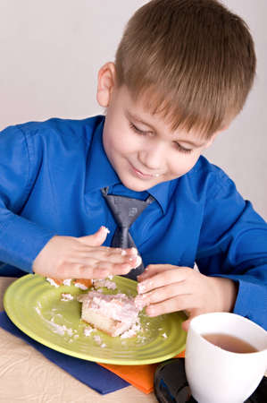portrait of a child who eats the cake photo
