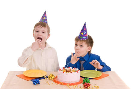 two boys eating a cake his hands isolated on white background photo