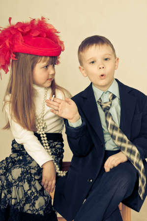 boy smokes a cigarette and a girl looks at him Stock Photo - 12628019