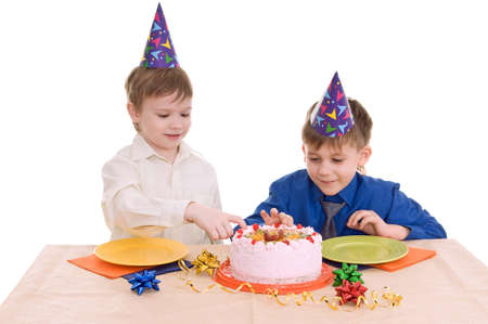 two boys eating a cake isolated on white background Stock Photo - 12628021