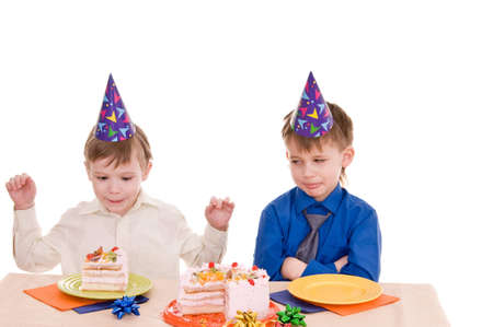 two thoughtful boys with a cake isolated on white background photo