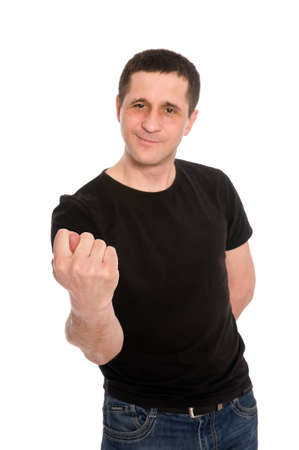 man in a black T-shirt showing a fig isolated on white background photo