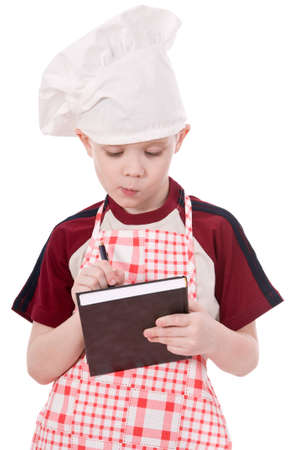 a pensive child chef isolated on white background Stock Photo - 12685274