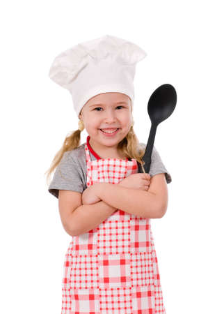 girl chef with large spoon isolated on white background photo