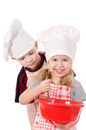 two children in chef's hat isolated on white background Stock Photo - 12914977