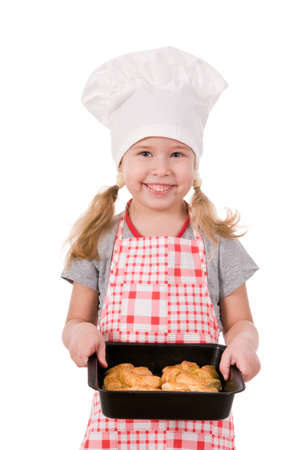 girl in chef's hat with baking  isolated on white background photo