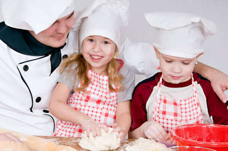 chef and children in the chefs prepare a meal photo