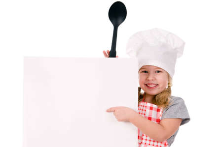 little girl child: girl in chefs hat indicates on blank sheet isolated on white background Stock Photo