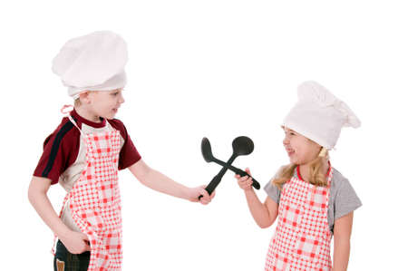 Two children dressed in chef isolated on the white background photo