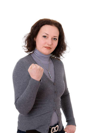 mid adult woman shows the fist  isolated on white background photo