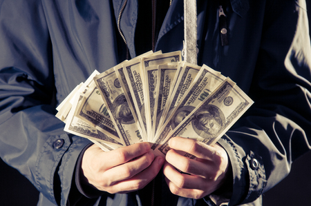 young man holding cash in hands photo