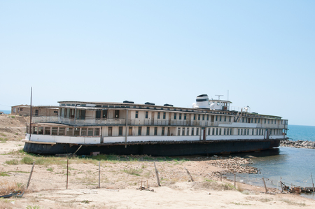 aground: Old ruined passenger ship was aground Stock Photo