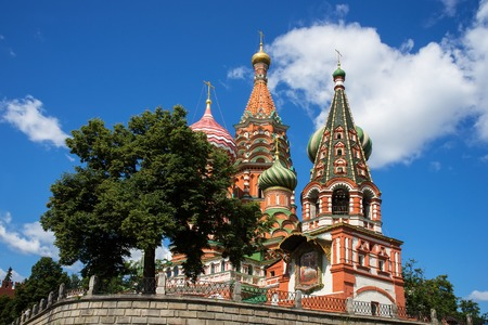 cupolas: The most famous architectural place for visiting and attraction in Moscow, Russia, Saint Basils cathedral with colorful cupolas and spectacular domes in traditional culture on cloudy blue sky