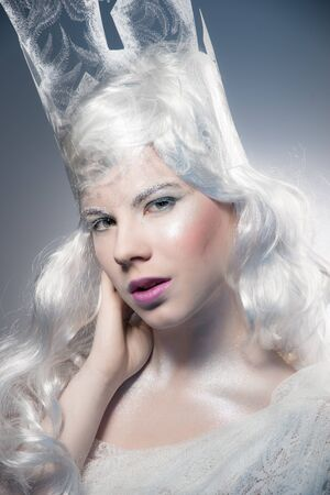 sexy christmas: Winter Beauty Woman. Christmas Girl Makeup.Winter Queen with Snow and Ice crown. Close up view. Stock Photo