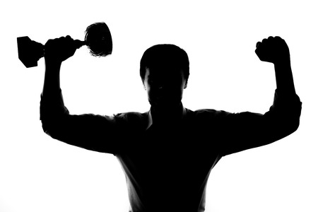 the victorious: One man happy strong victorious silhouette studio isolated on white background.