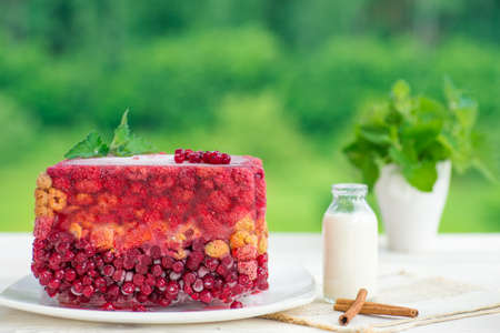 raspberry jelly: Jelly with berries: current, raspberry on green garden back.