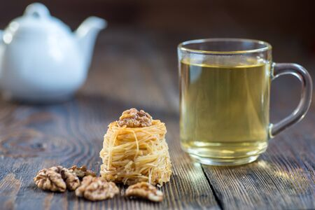 Sweet nests of vermicelli? arabian dessert with walnut and green herbal tea.