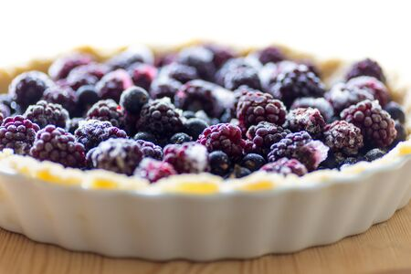 Blackberry pie and berries on rustic wooden table Stock Photo